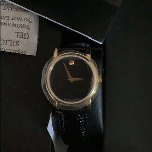 MOVADO BLACK AND GOLD WATCH